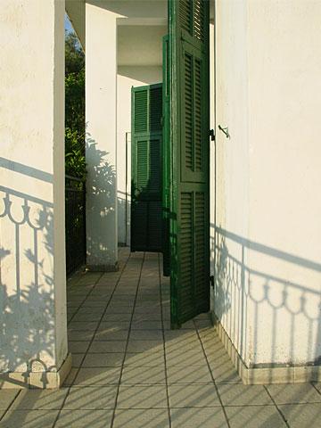 Shadow plays on the balcony