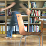 moving person and bookshelf