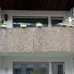 balcony with stone birds